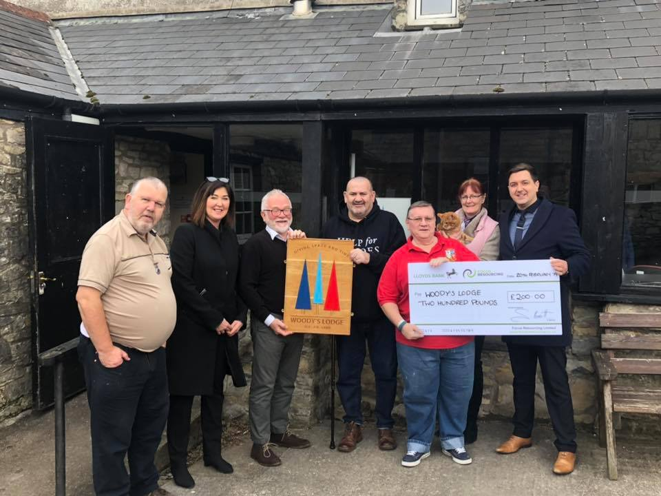Woody's Lodge receiving cheque from Focus Resourcing